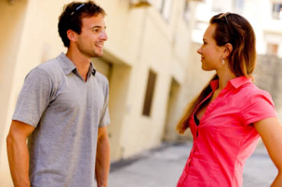 Attractive Young Couple talking, flirting